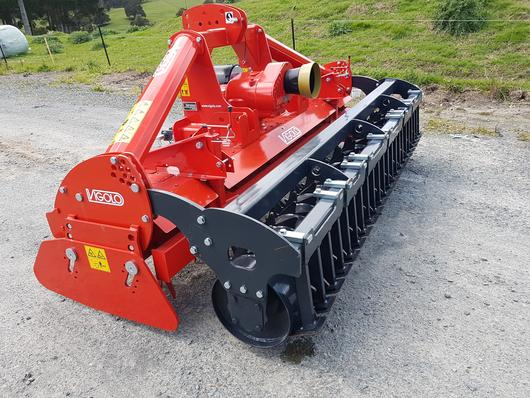 Power harrow with packer roller