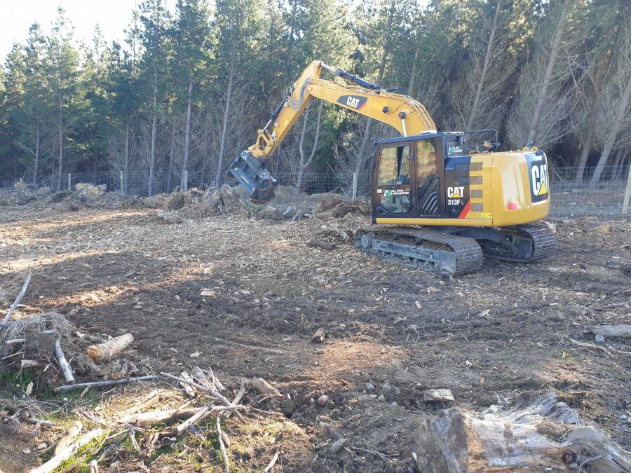 Fixed tooth forestry mulcher on CAT excavator