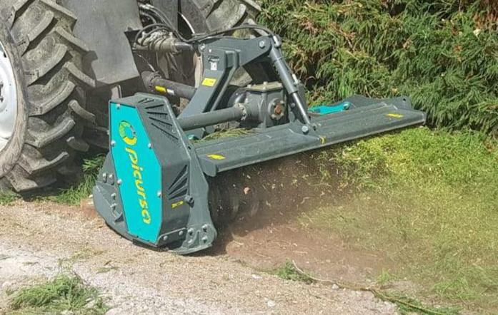 Tractor mounted forestry mulcher with fixed tungsten carbide teeth