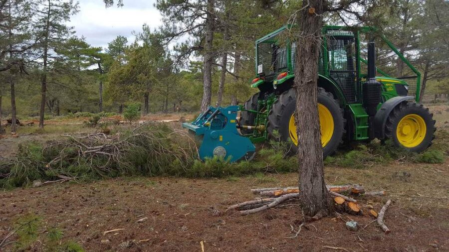 Forestry mulcher tidying up tree prunings